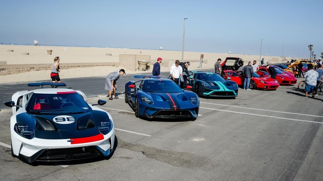 Supercars By The Sea - exotic cars lined up in front of beach background