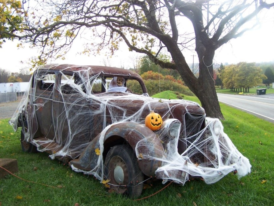 Trunk And Treat '30s sedan covered in fake spider webs