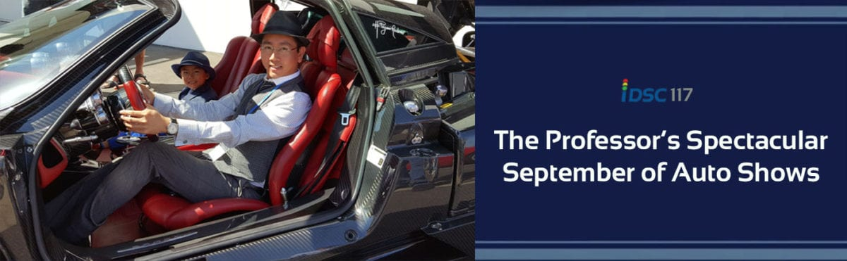 iDriveSoCal Podcast Banner 117 titled The Professor's Spectacular September of Auto Shows | iDriveSoCal's Professor with his son, the Associate Professor, pictured sitting in a super-car with doors open